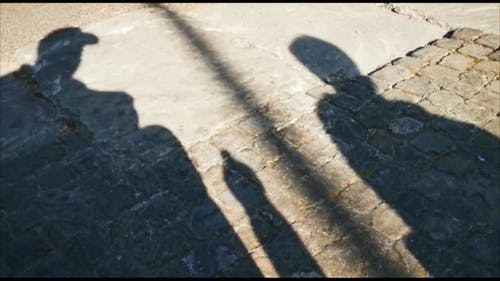 Shadow of People on the Brick Road