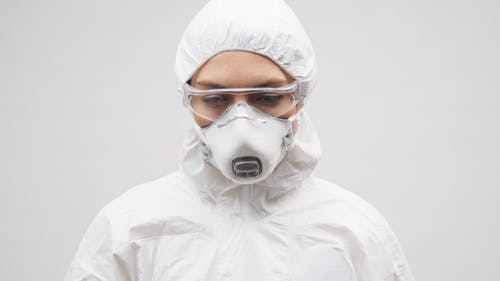 A Health Worker Wearing Protective Suits For Protection