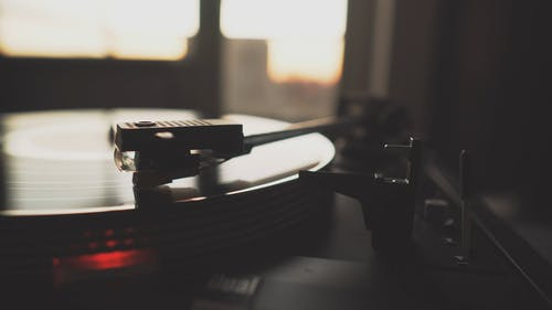 Close-up View Of A Classic Turntable Playing Music
