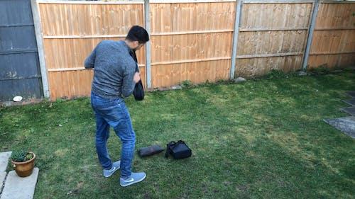 Man Setting Up Binoculars
