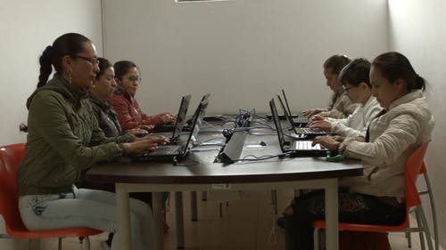 A Group Of Online Women Workers Working Together