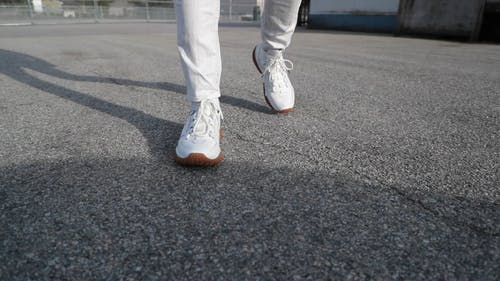 Video Of A Person Wearing White Sneakers Walking