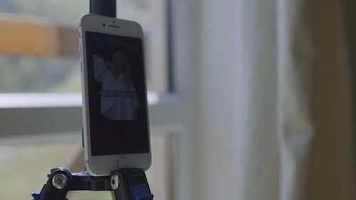Smartphone on a Tripod Taking Selfies