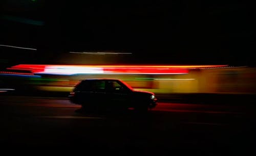 Blazing Neon Lights Surrounding A Stopped Car