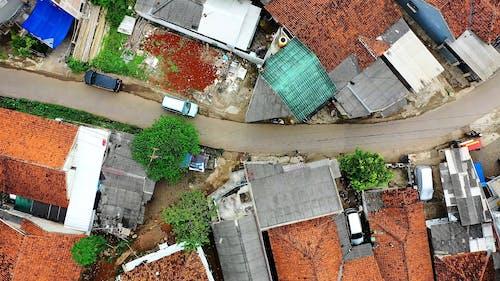 Drone Footage Of Road Between Houses