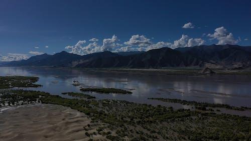 Drone Footage Of Lake Near Mountains