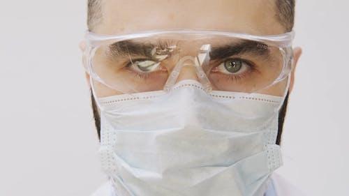 Man Wearing Face Mask And Eye Shield