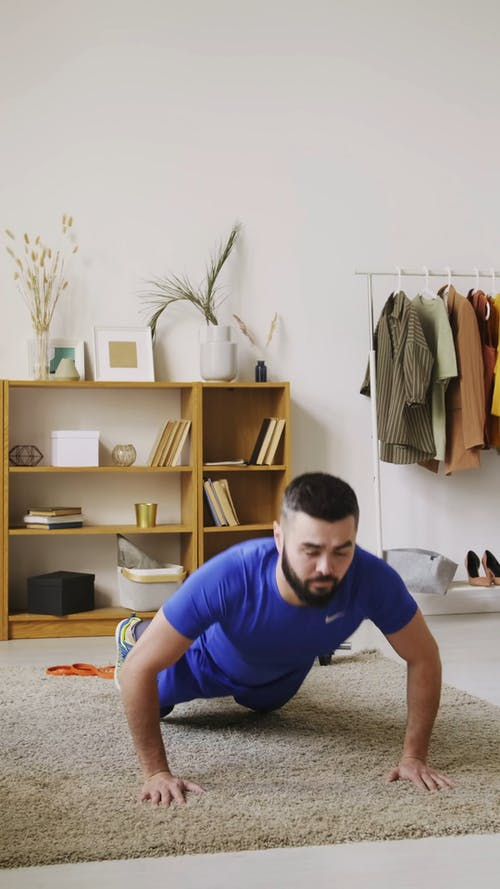A Bearded Man Exercising At Home