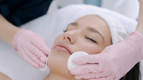A Woman Having A Facial Treatment