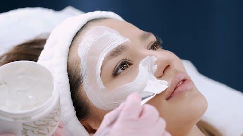 A Woman Getting A Facial Treatment