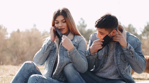 Couple Putting on Face Masks