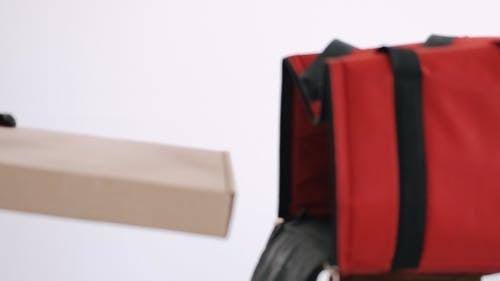 Delivery Man Disinfecting a Box