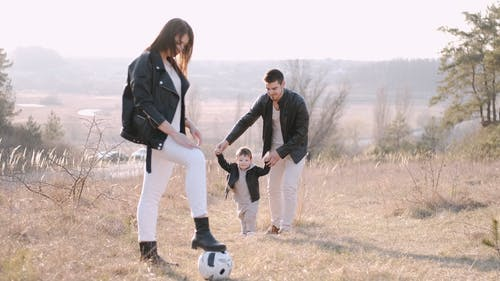 A Family Enjoying Their Time Outdoors