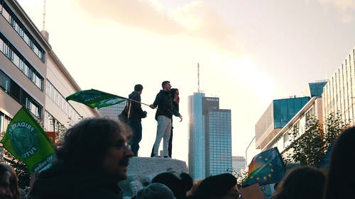 A Man Swaying the Flag He is Holding