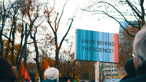 Science Advocate Protesters Holding A Poster In A Rally