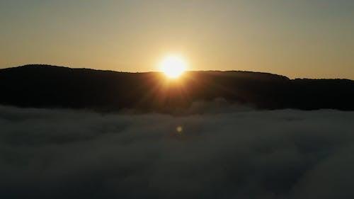 Drone Shot of Mountain Peak During Sunset