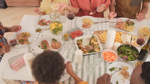 A Family Celebrating A Holiday By Dining Together