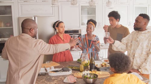 Family Gathers at the Kitchen while Drinking Wine