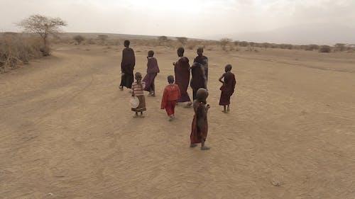 Local People Walking on a Desert Land
