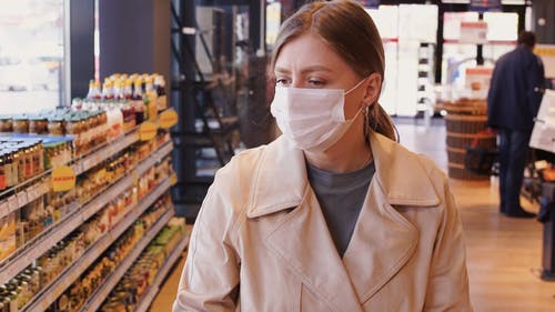 Woman Wearing A Mask In The Grocery