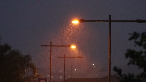 Visible Rain At Night Because Of The Street Lamps Light