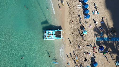 People Enjoying The Waikiki Beach In Hawaii