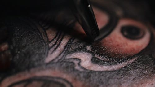 A Tattoo Machine Needle In Action