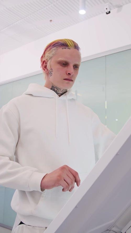 A Man Using a Touchscreen Computer