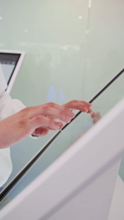 A Person Using a Touchscreen Computer