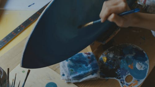 Painting A Wooden Board With Blue Colors