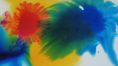 Artwork By Mixing Splatters Of Liquids Colors