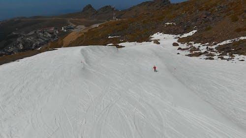Skiing Down The Mountain Of A Ski Resort