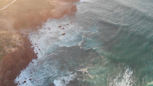 Drone Footage Of Mountain Cliffs Above The Sea Water