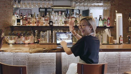 Two Women Meeting In A Bar