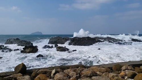Big Waves Crashing on Rocks