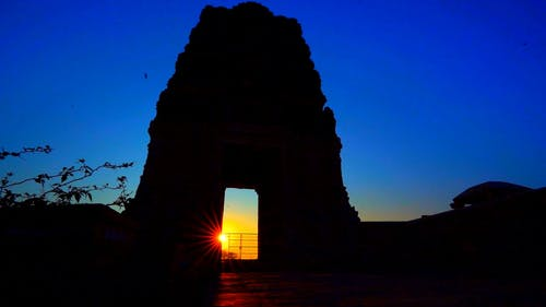 Watching Sunset Though The Gate Of A Stonewall