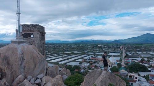 Man Walking on Big Rocks