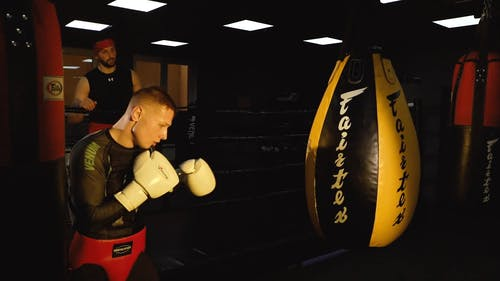A Boxer Hitting A Punching Bag In Training
