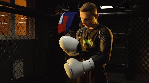 Man Fixing His Boxing Gloves