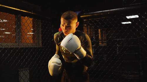 A Young Boxer Doing Shadow Boxing In The Gym
