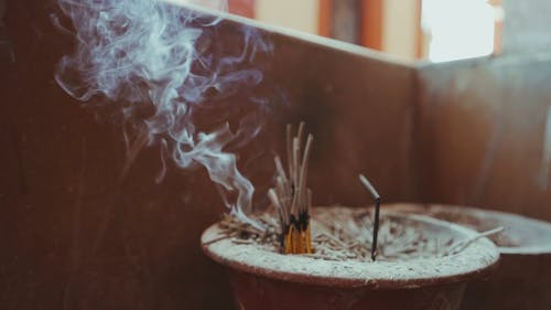 Smoke Coming From The Burning Incense Sticks