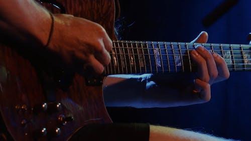 A Guitarist Playing An Electric Guitar