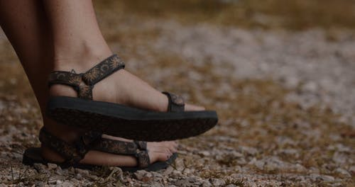 Person Wearing Black Sandals