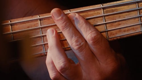 Close-up Video of Person Playing the Guitar