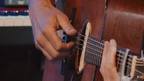 Man Playing Guitar