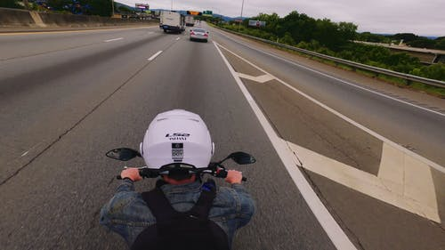 Time Lapse Footage of Man Riding Motorcycle