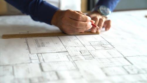 A Person Making a Blueprint