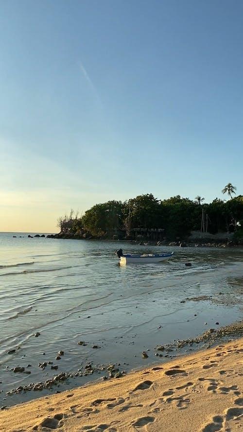 A Man Walking Along The Seashore