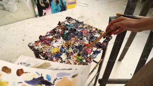 A Person Doing Abstract Painting on a Canvas