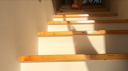 A Person Going Down The Stairs